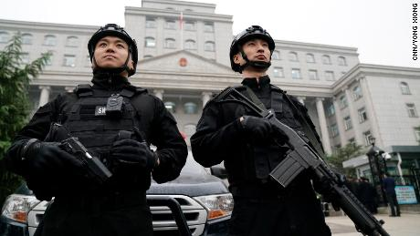 Two guards stand outside the Xingtai Intermediate People's Court in Hebei Province on Thursday November 7.