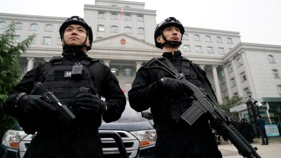 Two guards stand outside the Xingtai Intermediate People