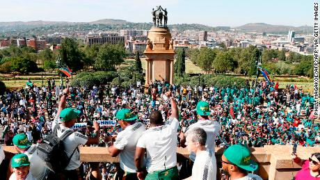 Springbok players celebrate from the Union Buildings, the seat of South Africa's government, before the start of their nation-wide trophy tour that will see the players engage with fans in Pretoria, Johannesburg, Soweto, Durban, East London, Port Elizabeth and Cape Town.
