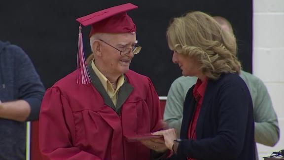 Cpl. Lewie Shaw donned a cap and gown over his military uniform.