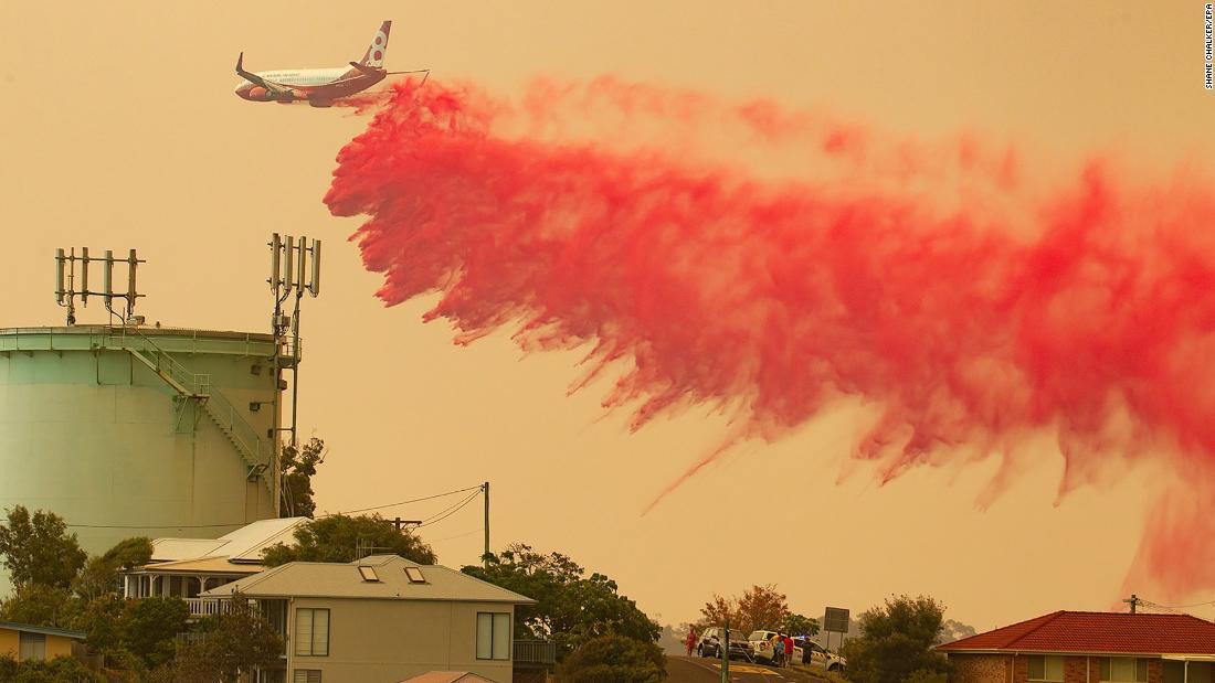 A water tanker aircraft drops fire retardant on a bushfire in Harrington, New South Wales, Australia, on Friday, November 8. Hot, windy conditions are wreaking havoc as bushfires burn out of control across parts of New South Wales.