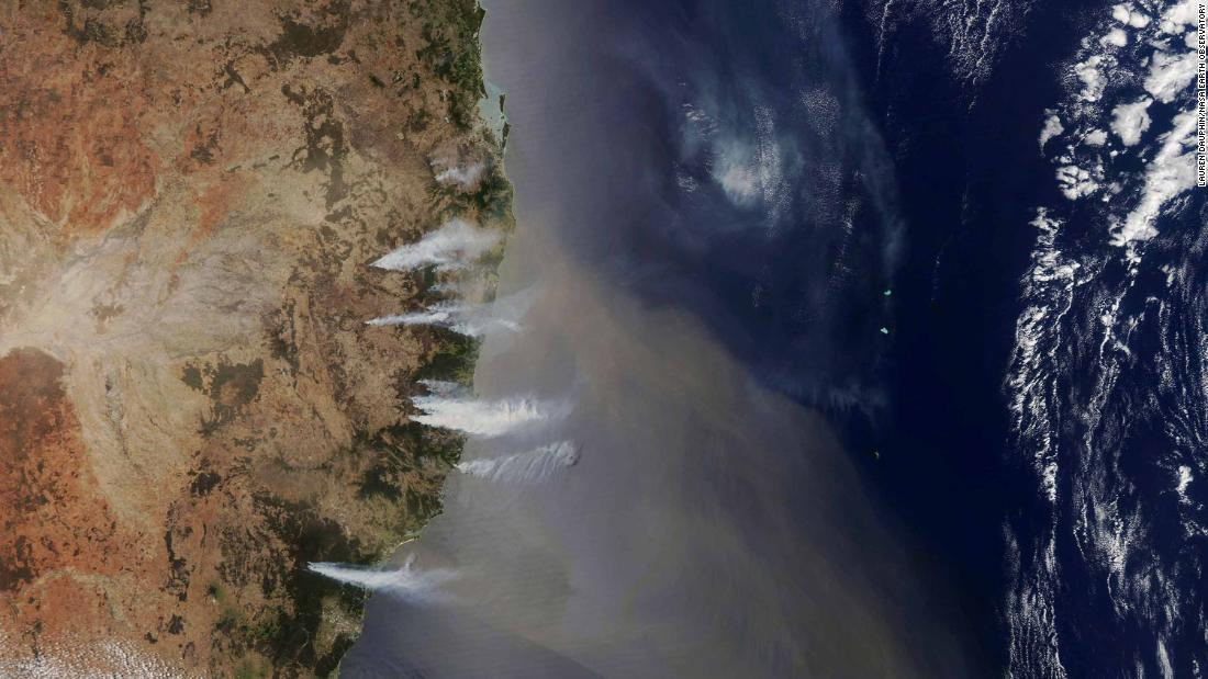 In this handout photo from NASA's Aqua satellite, destructive bushfires are seen off the coast of New South Wales, sending smoke billowing over the Tasman Sea on November 7.