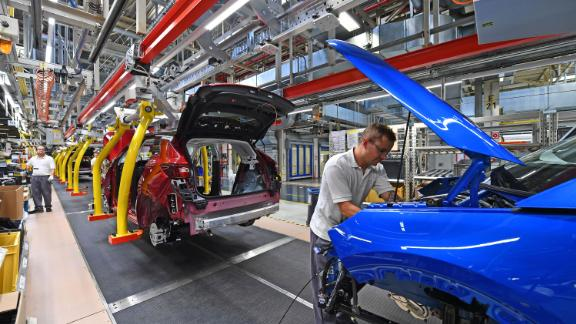 "A man works on the assembling of an Opel ""Grandland X"" SUV car at Opel's plant in Eisenach, eastern Germany, on August 28, 2019. (Photo by Martin Schutt / dpa / AFP) / Germany OUT (Photo credit should read MARTIN SCHUTT/DPA/AFP via Getty Images)"