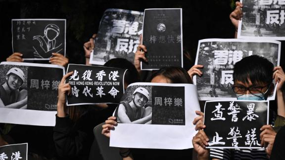 Students of the Hong Kong University of Science and Technology (HKUST) participate in a march on November 8, after hospital officials confirmed the death of student Chow Tsz-lok, 22. Police say Chow, a computer sciences student at HKUST, fell from the third floor to the second floor of a parking garage in the residential area of Tseung Kwan O in the early hours of November 4.