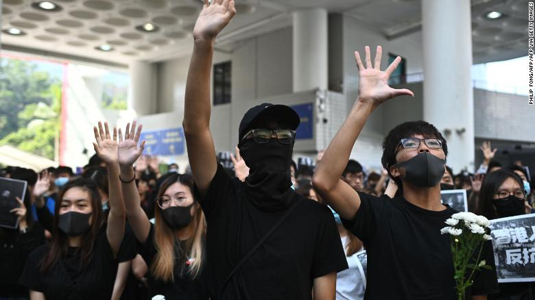 Students of the Hong Kong University of Science and Technology (HKUST) participate in a march towards HKUST president Wei Shyy's lodge in Hong Kong on November 8, 2019, following the death earlier in the day of student Chow Tsz-lok.