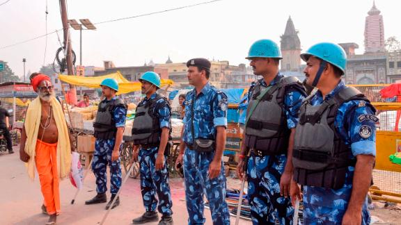 Security personnel stand guard on a street in Ayodhya on November 7, 2019, ahead of a Supreme Court verdict on the future of the site of the 16th-century Babri mosque.