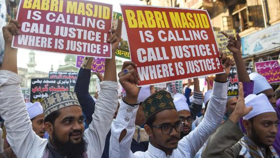 Indian Muslim supporters and activists take part in a protest to mark the 26th anniversary of the demolition of the 16th century Babri Masjid.