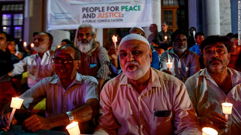 Activists stage a candle light vigil urging people belonging to all religious communities to maintain peace and harmony before the Supreme Court verdict on Ayodhya, in Bangalore on November 7, 2019.