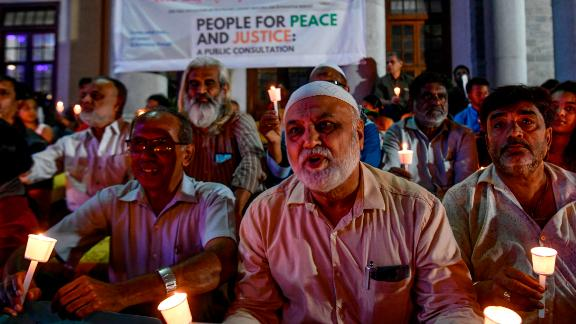 Activists belonging to 'People for Peace and Justice' stage a candle light vigil urging people belonging to all religious communities to maintain peace and harmony regardless of the outcome of the Supreme Court verdict on Ayodhya.