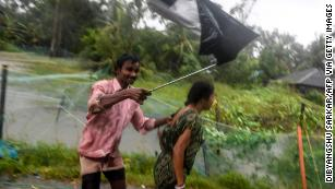 Villagers struggle against strong winds to enter a relief ceter as Cyclone Bulbul approaches eastern India.
