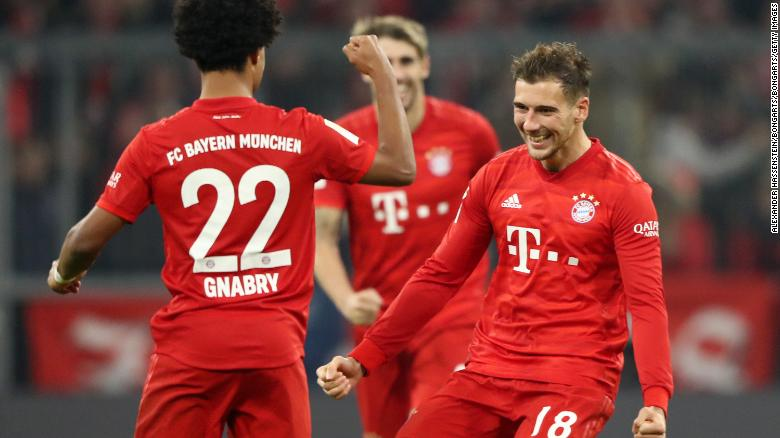 Serge Gnabry celebrates with teammate Leon Goretzka after scoring his team's second goal during the 4-0 defeat of Borussia Dortmund at the Allianz Arena.