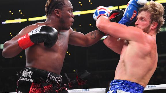 KSI (left) throws a punch as Logan Paul defends in their professional bout at the Staples Center in Los Angeles which KSI won on a points decision.