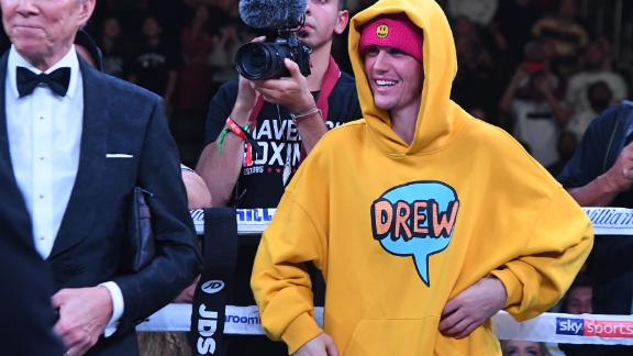 """Celebrity backer: Justin Bieber was part of Logan Paul's team at the Staples Center and disagreed with the eventual split decision. """"Logan was the better fighter. Period,"""" he wrote on his Instagram account."""