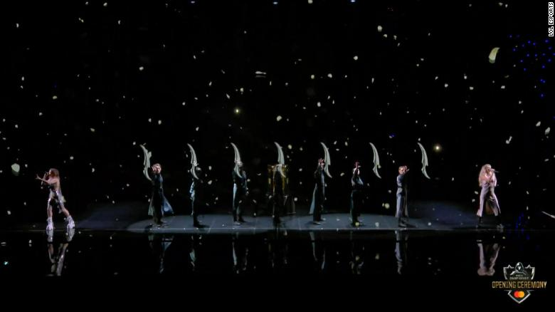Dancers perform in time with virtual blades via a hologram-like display for the League of Legends World Championship of 2019.