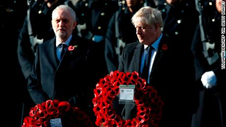 The UK's Prime Minister Boris Johnson and opposition Labour Party leader Jeremy Corbyn prepare to lay wreaths as they take part in the Remembrance Sunday ceremony.
