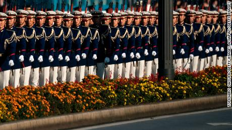 An escort of honorary procession outside the Imperial Palace leads the climbing parade.
