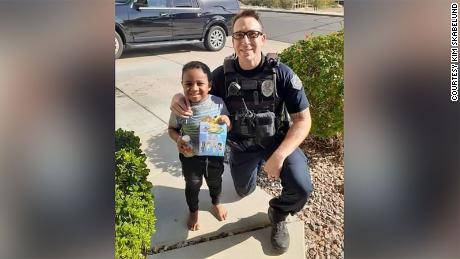 "Officer Randolph ""Scott"" Valdez and 5-year-old Charlie Skabelund after Officer Valdez responded to Charlie's 911 call asking for a McDonald's Happy Meal."