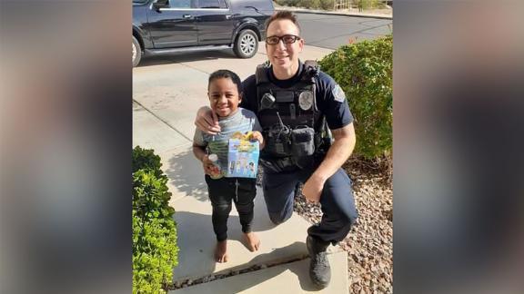 """Officer Randolph """"Scott"""" Valdez and 5-year-old Charlie Skabelund after Officer Valdez responded to Charlie"""