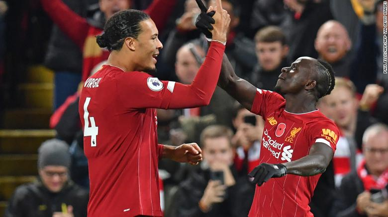 Liverpool's Senegalese striker Sadio Mane celebrates with Virgil van Dijk (left) after scoring his side's third goal early in the second half at Anfield.