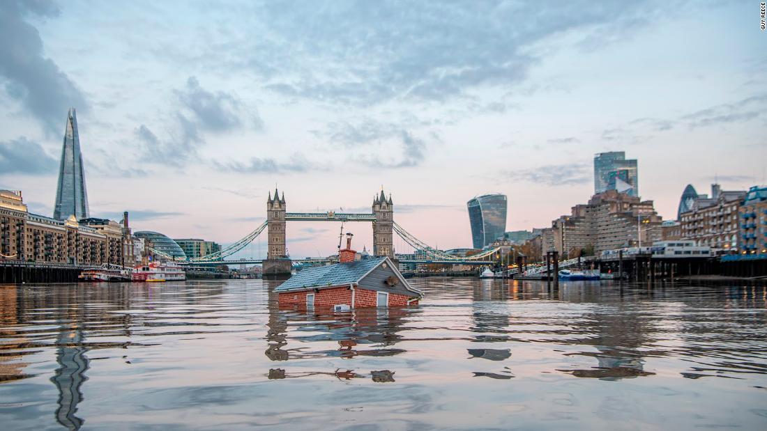 Extinction Rebellion activists sail 'sinking house' down River Thames