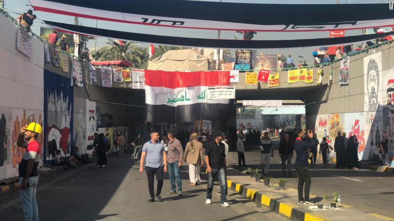 Protesters walk through the tunnel under Tahrir Square full of murals drawn by protesters and artists over recent weeks.