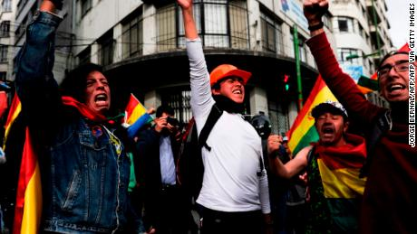 People take to the streets of La Paz to celebrate the resignation of Bolivian President Evo Morales on November 10, 2019.