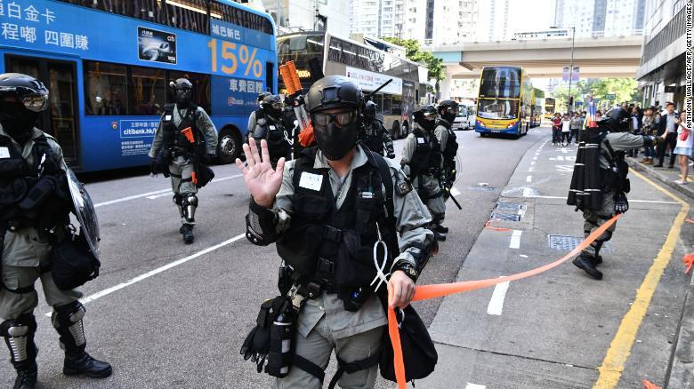 Police officers in Sai Wan Ho, Hong Kong, where a protester was shot on November 11, 2019.