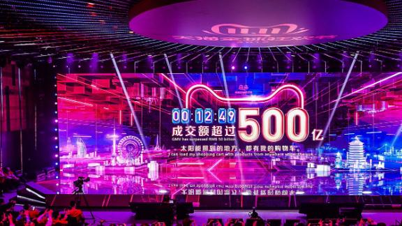 A screen shows the gross merchandise volume, a measure of sales, after 12 minutes 49 seconds of Singles Day sales, as it reaches about 7,147,554,107 USD in Hangzhou in China