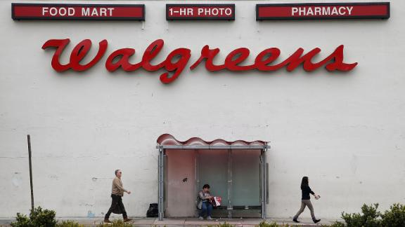 SAN FRANCISCO, CA - JULY 09:  Pedestrians walk by a Walgreens store on July 9, 2015 in San Francisco, California. Walgreens Boot Alliance Inc. reported  better than expected third quarter profits with net earnings of $1.3 billion, or $1.18 per share, compared to $714 million, or $0.74 per share one year ago.  (Photo by Justin Sullivan/Getty Images)
