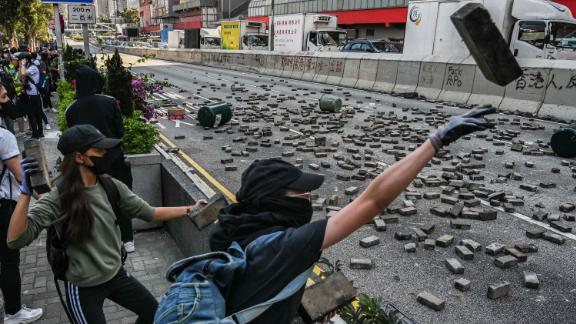 Protesters throw bricks in Wong Tai Sin district on November 11.