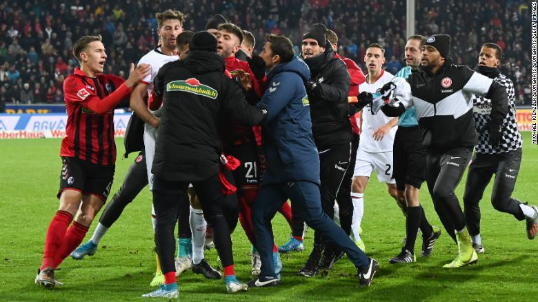 A scrap breaks out at the end of the Bundesliga match between Frankfurt and Freiburg.
