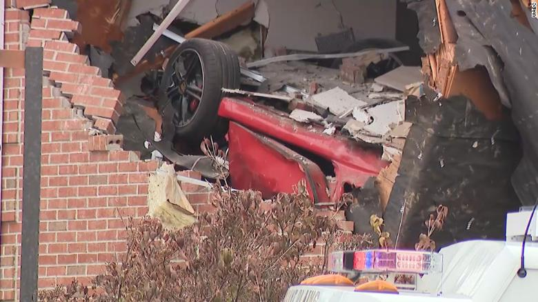 Porsche crashes into second story building, killing two