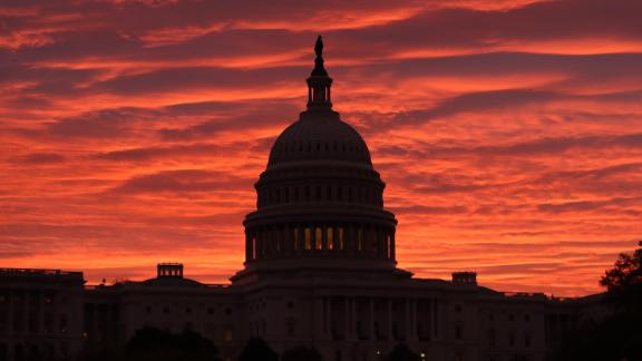 The sky turns to a fiery color as the sun begins to rise behind the U.S. Capitol building, on November 7, 2019 in Washington, DC.