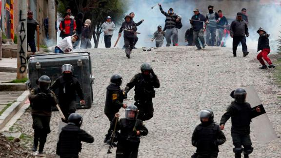 Supporters of former President Evo Morales clash with police in La Paz, Bolivia, on Monday.