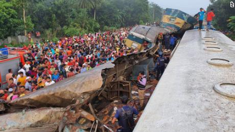 People gather near badly damaged coaches after two trains collided in Brahmanbaria district, 82 kilometers (51 miles) east of the capital, Dhaka, Bangladesh, on Tuesday, November 12, 2019.
