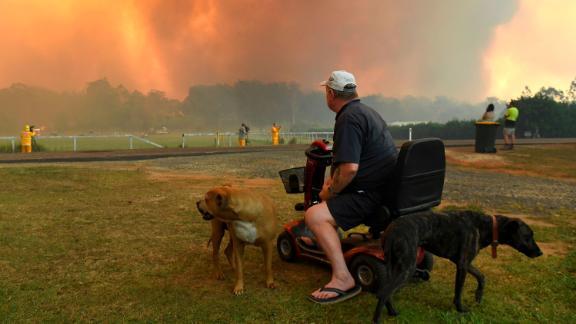 Locals watch the fires impact farmland near Nana Glen on November 12.