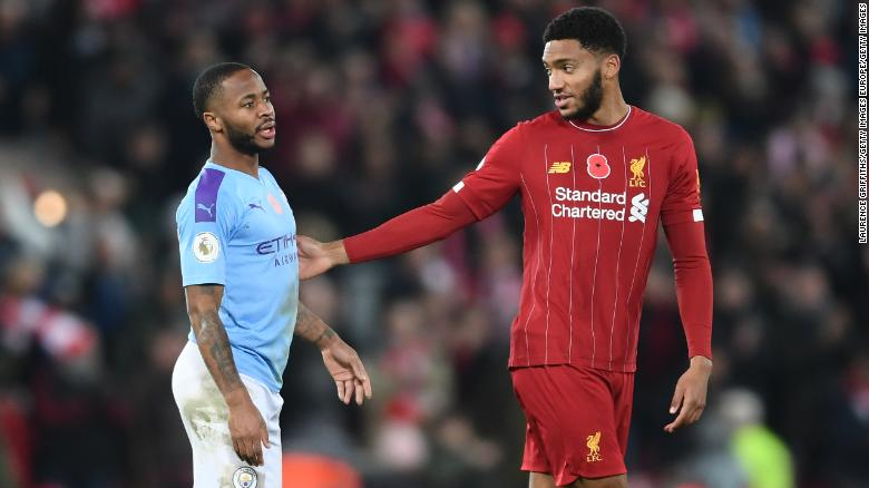 Raheem Sterling speaks with Joe Gomez following the English Premier League match between Liverpool and Manchester City on Sunday.