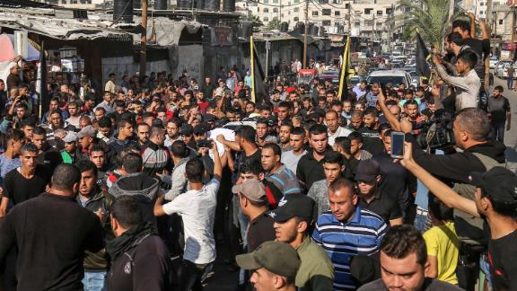 Mourners carry the body of Baha Abu Al-Ata during his funeral in Gaza City on November 12.