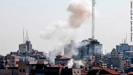 Smoke is seen Gaza City following an Israeli air strike on November 12.