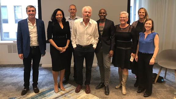 Richard Branson (center) poses with a team in Cape Town, South Africa following the launch of his new Centre for Entrepreneurship