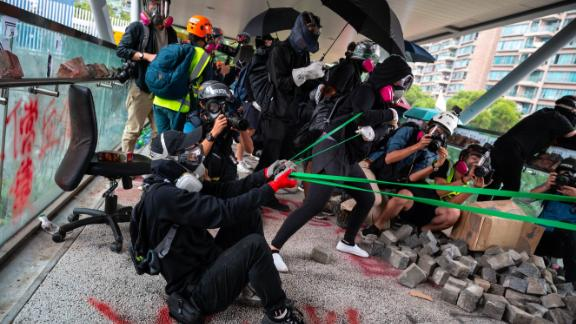 Protesters use a catapult against police during a protest Hong Kong