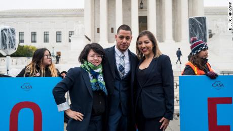 DACA recipients Carolina Fung Feng, Martin Batalla Vidal and Eliana Fernández pose for a photo before entering the U.S. Supreme Court on Tuesday, November 12, 2019.