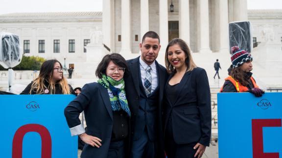 DACA recipients Carolina Fung Feng, Martin Batalla Vidal and Eliana Fernández pose for a photo before entering the U.S. Supreme Court on Tuesday, November 12, 2019.