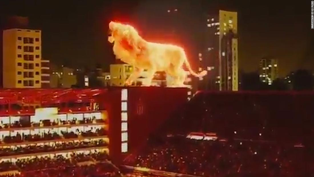 Estudiantes reopens stadium with flaming lion hologram - CNN thumbnail