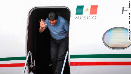 Bolivian ex-President Evo Morales waves upon landing in Mexico City, on November 12, 2019, where he was granted exile after his resignation. - Landlocked Bolivia, in crisis after its president quit amid protests over a disputed election, is among Latin America's poorest countries despite having huge gas reserves. (Photo by PEDRO PARDO / AFP) (Photo by PEDRO PARDO/AFP via Getty Images)