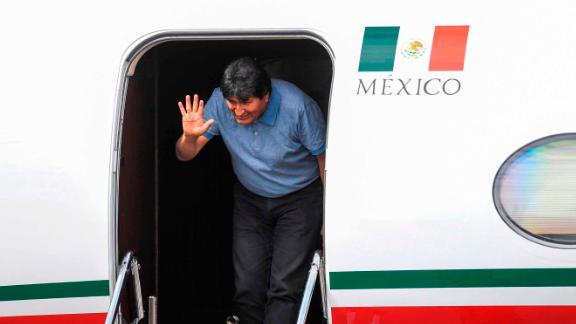 Morales waves upon landing in Mexico City.