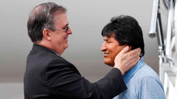 Mexican Foreign Minister Marcelo Ebrard, left, welcomes Morales upon his arrival in Mexico City.