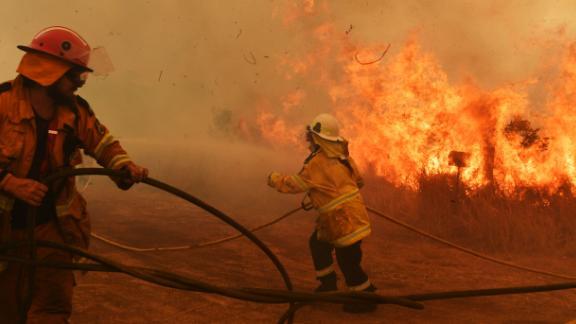 Firefighters battle a spot fire in Hillville on November 13.