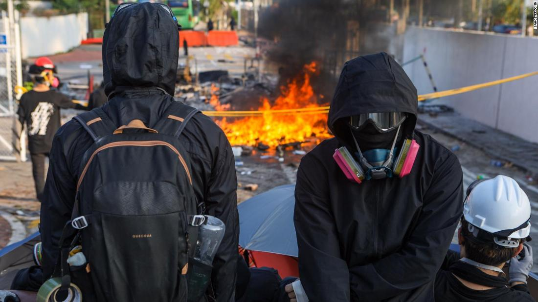 Hong Kong university under 'siege' from police as violence spreads