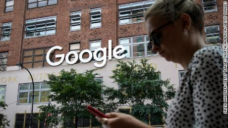 NEW YORK, NY - JUNE 3: A woman looks at her smartphone as she walks past Google Building 8510 at 85 10th Ave on June 3, 2019 in New York City. Shares of Google parent company Alphabet were down over six percent on Monday, following news reports that the U.S. Department of Justice is preparing to launch an anti-trust investigation aimed at Google. (Photo by Drew Angerer/Getty Images)